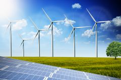 Photovoltaics solar panels and wind turbines generating alternative energy. Photovoltaic solar panels and wind turbines generating alternative renewable energy Royalty Free Stock Image