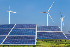 Photovoltaics solar panels and wind turbines generating electricity in solar power station. Alternative energy from nature Ecology concept royalty free stock photo