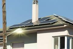 Photovotaic solar panels house roof. Sunny day Stock Photos