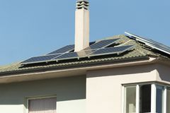 Photovotaic solar panels house roof. Sunny day Stock Photo