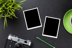 Phots over desk table, camera, coffee and flower Royalty Free Stock Photo