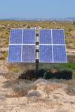 Phovoltaic solar panel. A solar panel in and isolated sandy land stock image
