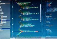 Php code on blue background in code editor. Close up stock photos
