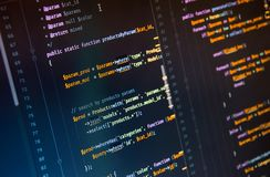 Php code on dark background in code editor. Close-up stock photo