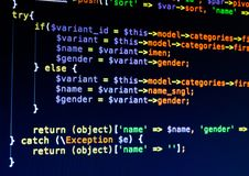 Php code of different colors on the dark blue background. Macro stock photo