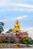 Phra Buddha Nawa Lan Tue. Beautiful golden buddha statue of Phra Buddha Nawa Lan Tue on the banks of the Mekong River at Golden Triangle Park Sob Ruak during the royalty free stock photography
