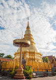Phra That Hari Phunchai golden pagoda in Thai temple. Stock Images