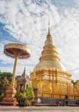 Phra That Hari Phunchai golden pagoda in Thai temple. Royalty Free Stock Photos