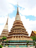 Phra Maha Chedi. Phra Si Sanphet ( front ) decorated with green glazed tiles  and  Dilok (back and left ) decorated with white glazed tiles  in Wat Pho,Bangkok Royalty Free Stock Photo