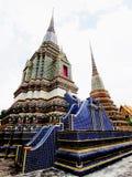 Phra Maha Chedi Sri Suriyothai. Phra Maha Chedi Sri Suriyothai is adorned with blue tiles . It has dark blue color and is the pagoda of King Rama 4th of Royalty Free Stock Photos