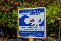 PHRA NANG, THAILAND - FEBRUARY 09, 2018: Outdoor view of informative sign of stunami hazard zone on Phra nang island.  stock image