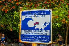 PHRA NANG, THAILAND - FEBRUARY 09, 2018: Outdoor view of informative sign of stunami hazard zone on Phra nang island.  royalty free stock photo