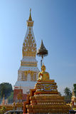 Phra That Phanom Chedi and Gold buddha Stock Image