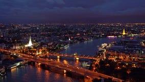 Phra Phuttha Yodfa Bridge, Memorial Bridge with buildings at Chao Phraya River. Bangkok at sunset, Thailand. 4K cityscape VDO.  stock video footage