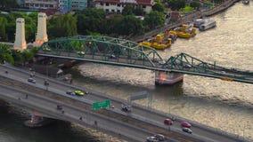 Phra Phuttha Yodfa Bridge, Memorial Bridge in transportation concept at Chao Phraya River. Bangkok at sunset, Thailand. 4K. Cityscape VDO stock video