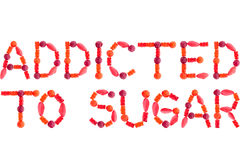 Phrase ADDICTED TO SUGAR made of red sugary candies Stock Image