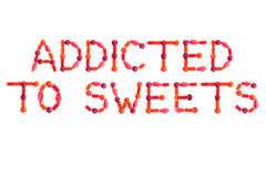 Phrase ADDICTED TO SWEETS made of red sugary candies. Isolated on white background Royalty Free Stock Images
