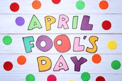 Phrase `April fool`s day. ` on wooden background stock images