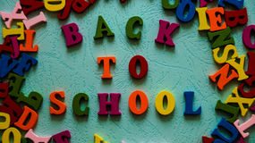 The phrase `Back to school` wooden colored letters on the table mint color. Photo Royalty Free Stock Images