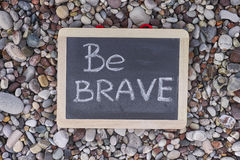 Phrase Be Brave on blackboard Stock Photography