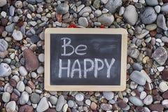 Phrase Be Happy on blackboard Royalty Free Stock Photo