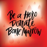 Phrase  Be a Hero Donate bone marrow with red drops on red background. Vector lettering of  text Be a Hero Donate bone marrow. Modern calligraphy.Template of Royalty Free Stock Photo