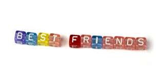 Phrase best friends. On multicolored wooden cubes white isolated Royalty Free Stock Photos