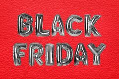 Phrase BLACK FRIDAY made of foil balloon letters on background