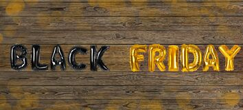 Phrase BLACK FRIDAY made of foil balloon letters on background. Banner design