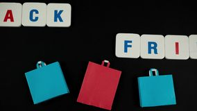 Phrase black friday with paper bags. Stop motion