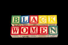 The phrase black women displayed on a black background Stock Images