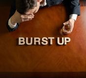 Phrase Burst Up and devastated man composition Royalty Free Stock Photo