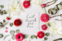Phrase Do small things with great love written in calligraphy style Stock Photography
