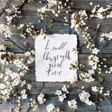 Phrase `Do small things with great love` written in calligraphy style on paper with wreath frame Royalty Free Stock Photography