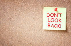 The phrase don't look back written on sticky note. room for text Stock Photos