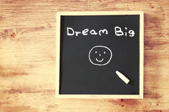 The phrase dream big written on chalkboard Royalty Free Stock Photos