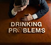 Phrase Drinking Problems and devastated man Royalty Free Stock Photo