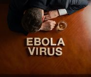 Phrase Ebola Virus and devastated man composition Stock Image