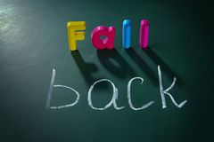 Phrase FALL BACK. On chalkboard background Royalty Free Stock Images