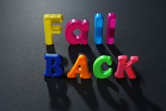 Phrase FALL BACK. On chalkboard background Stock Photo