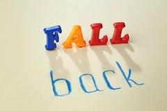 Phrase FALL BACK. On light background Stock Photography