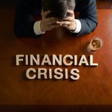 Phrase Financial Crisis and devastated man Royalty Free Stock Photography