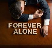 Phrase Forever Alone and devastated man Stock Image