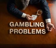 Phrase Gambling Problems and devastated man Stock Image