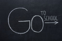 Phrase go to school with arrow sign Stock Images