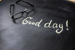The phrase Good day on the blackboard Stock Photography