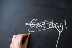 The phrase Good day crossed out and painted. Stock Image