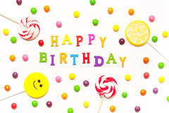 The phrase happy birthday, lollipops, candy smile on Royalty Free Stock Photography