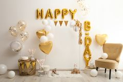 Phrase HAPPY BIRTHDAY made of balloon letters in decorated room