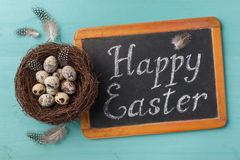 Phrase Happy Esther on chalkboard and nest with eggs Royalty Free Stock Photos